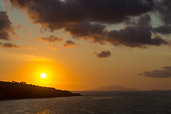 Sorrento, Italy, September 20 2017. The sun sets over il Capo in Sorrento, Italy, with the Island of Ischia on the horizon. © Paul Davey