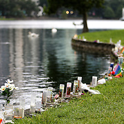 Mourners are seen at a small makeshift memorial at Lake Eola Park for the victims of the Pulse nightclub where many victims were killed in the deadliest shooting in modern U.S. History on Tuesday, June 14, 2016, in Orlando, Fla. (Alex Menendez via AP)