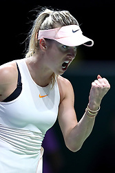 October 21, 2018 - Singapore, Singapore - Elina Svitolina of the Ukraine reacts to winning a point during the match between Petra Kvitova and Elina Svitolina on day 1 of the WTA Finals at the Singapore Indoor Stadium. (Credit Image: © Paul Miller/ZUMA Wire)
