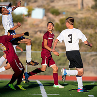 100813      Brian Leddy<br /> Gallup Bengal Matt  Mabrito (26) takes a header while trying to win the ball from his Belen Eagle defenders during Tuesday's game at Public School Stadium.
