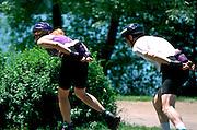 Adult couple age 30 rollerblading around Lake Harriet.  Minneapolis  Minnesota USA
