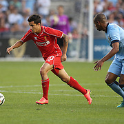 Philippe Coutinho, (left), Liverpool, is challenged by Fernando, Manchester City, during the Manchester City Vs Liverpool FC Guinness International Champions Cup match at Yankee Stadium, The Bronx, New York, USA. 30th July 2014. Photo Tim Clayton