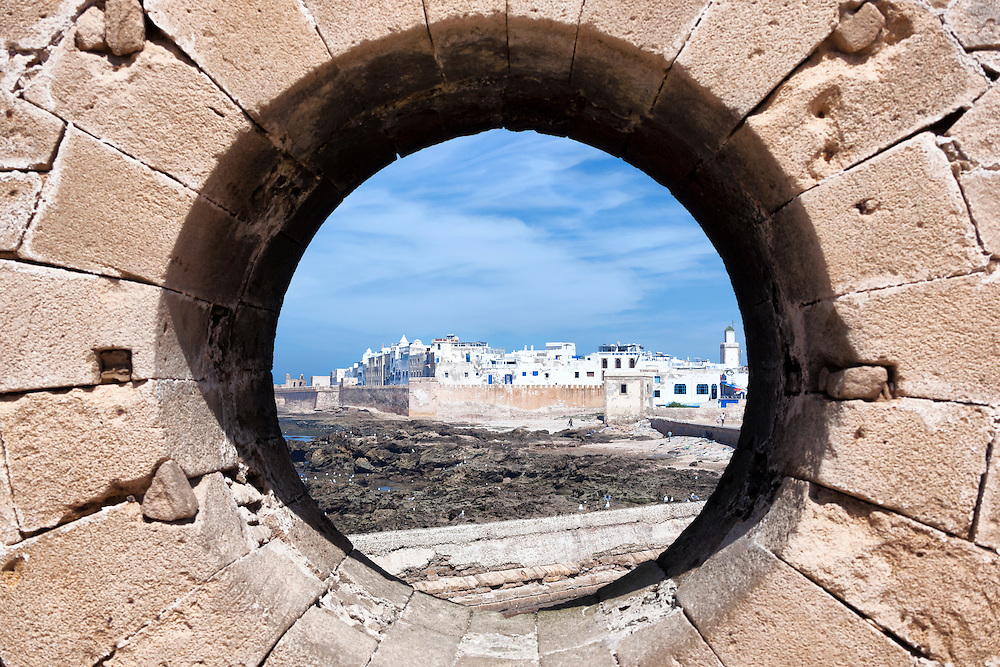View of the city of Essaouira through a rampart hole.