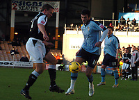Photo: Paul Greenwood.<br />Port Vale v Swansea City. Coca Cola League 1. 18/11/2006. Swansea's Kristian O'Leary, left, closes in on Vale's Jeff Smith