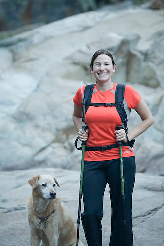 Portrait of young woman hiking and dog near Emerald Bay. Lake Tahoe, CA.