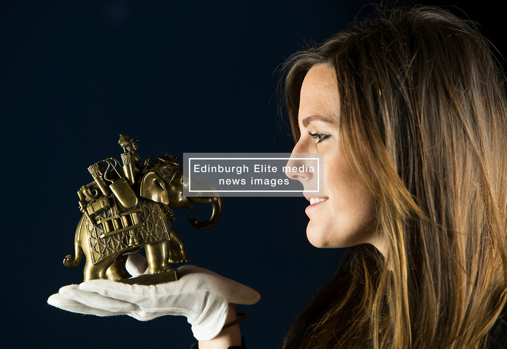 Works of art that brought the wonders of India to Britain at the end of the 19th century are to go on display in Scotland for the first time in over 130 years, in a new exhibition opening at The Queen's Gallery, Palace of Holyroodhouse on Friday, 15 December. Exploring the historic visit made by Albert Edward, Prince of Wales (later King Edward VII) at the end of the 19th century, Splendours of the Subcontinent: A Prince's Tour of India 1875–6 features some of the finest examples of Indian design and craftsmanship, presented to the Prince as part of the traditional exchange of gifts.<br /> <br /> Pictured:  One of a set of 18th century small brass military figures presented to the Prince during his visit to Madras in South India. Held by Stephanie Cliffe of the Royal Collection
