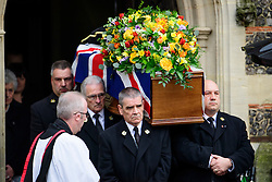 © Licensed to London News Pictures. 01/02/2017. Watford, UK. The coffin leaving the church during the funeral of former England football team manager Graham Taylor at St Mary's Church in Watford, Hertfordshire. The former England, Watford and Aston Villa manager,  who later went on to be chairman of Watford Football Club, died at the age of 72 from a suspected heart attack. Photo credit: Ben Cawthra/LNP