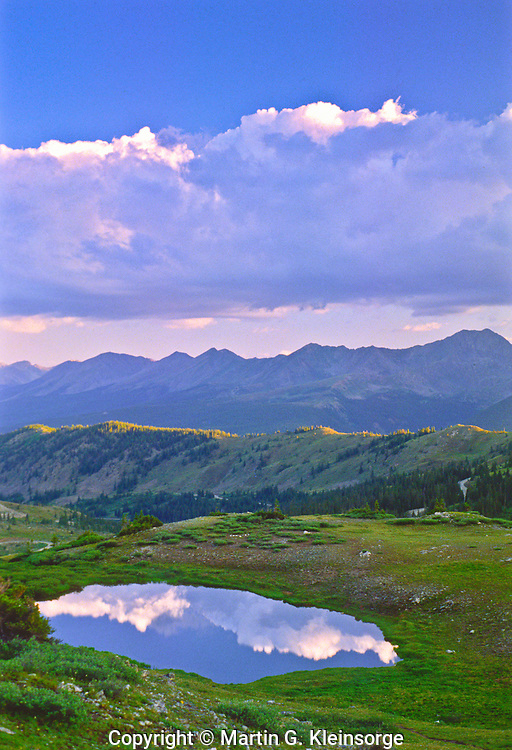 Could reflections in a alpine tarn on Cottonwood Pass, Sawatch Mountains, Colorado.