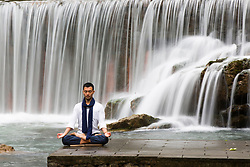 November 20, 2018 - Guang'an, China - People practice yoga in front of waterfall at Huaying Mountain in Guang'an, southwest China's Sichuan Province. (Credit Image: © SIPA Asia via ZUMA Wire)