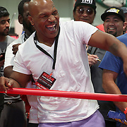 LAS VEGAS, NV - SEPTEMBER 13: Former champion Mike Tyson laughs at some boxers in the mini ring during the Box Fan Expo at the Las Vegas Convention Center on September 13, 2014 in Las Vegas, Nevada.   (Photo by Alex Menendez/Getty Images) *** Local Caption ***Mike Tyson