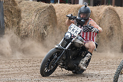 Hooligan Flat Track Racing in front of the main stage at the Buffalo Chip during the annual Sturgis Black Hills Motorcycle Rally. SD, USA. August 10, 2016. Photography ©2016 Michael Lichter.