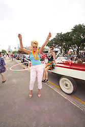 Stock photo of a woman hula hooping in the parade