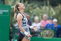 NOTTINGHAM, ENGLAND - JUNE 13: Magdalena Rybarikova of Slovakia looks up to the sky after losing a point against Mona Barthel of Germany during Day Five of the Nature Valley Open at Nottingham Tennis Centre on June 13, 2018 in Nottingham, United Kingdom.