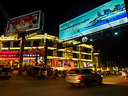 """13 FEBRUARY 2019 - SIHANOUKVILLE, CAMBODIA:  The Golden Pearl Slot, a Chinese owned casino in Sihanoukville. There are about 80 Chinese casinos and resort hotels open in Sihanoukville and dozens more under construction. The casinos are changing the city, once a sleepy port on Southeast Asia's """"backpacker trail"""" into a booming city. The change is coming with a cost though. Many Cambodian residents of Sihanoukville  have lost their homes to make way for the casinos and the jobs are going to Chinese workers, brought in to build casinos and work in the casinos.      PHOTO BY JACK KURTZ"""