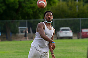 North Dallas HS QB Devion Long throws a pass during the Bulldogs first day of practice since the Covid-19 Pandemic began. The team's season will be a short one with only six games and two scrimmages .(Photo by Jaime R. Carrero)