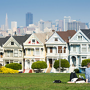 Painted ladies of Alamo Square, San Francisco with downtown are in background