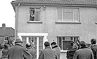 Major Ronald Bunting, who the previous day, 27th January 1969, had been sentenced, along with fellow loyalist, Rev Ian Paisley, to 3 months jail, conducts a press conference from a first floor of his home at Dundonald, Belfast, N Ireland. The following day he was arrested. 196901280017b.<br />