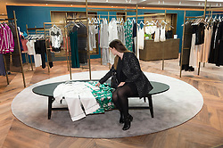 © Licensed to London News Pictures. 04/04/2016.  A customer sitting down viewing underwear and night time wear of the new SELFRIDGES Body Studio - the world's first fully integrated bodywear department and the largest retail space ever opened by the iconic London store. Covering over 37,000 sq ft, customers will experience over 3,000 brands and more than 5,000 different clothing options.London, UK. Photo credit: Ray Tang/LNP