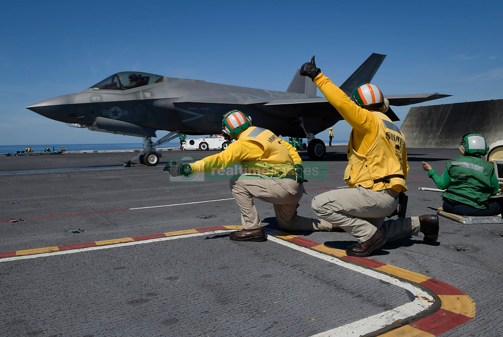 ATLANTIC OCEAN (Aug. 20, 2018) An F-35C Lightning II from the Rough Raiders of Strike Fighter Squadron (VFA) 125 prepares to launch from the flight deck of the Nimitz-class aircraft carrier USS Abraham Lincoln (CVN 72). (U.S. Navy photo by Mass Communication Specialist 1st Class Brian M. Wilbur/Released) 180820-N-FK070-2050