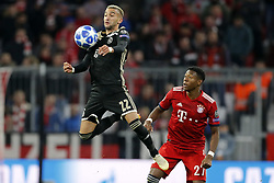 (l-r) Hakim Ziyech of Ajax, David Alaba of FC Bayern Munchen during the UEFA Champions League group E match between Bayern Munich and Ajax Amsterdam at the Allianz Arena on October 02, 2018 in Munich, Germany