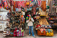 Pisac, Peru - July 14, 2013: man playing pan flute at Pisac market in the peruvian Andes at Cuzco Peru on july 14th, 2013