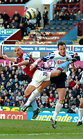 Photo: Ed Godden.<br />Aston Villa v Portsmouth. The Barclays Premiership. 04/03/2006. <br />Kevin Philips (L) and Pompey's Andy O'Brien clash in the air.