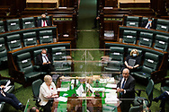Members of Parliament yell across the table during Question Time.