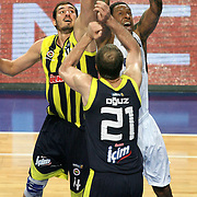 Efes Pilsen's Lawrence ROBERTS (C) and Fenerbahce Ulker's Kaya PEKER (L) during their Turkish Basketball league derby match Efes Pilsen between Fenerbahce Ulker at the Sinan Erdem Arena in Istanbul Turkey on Sunday 24 April 2011. Photo by TURKPIX