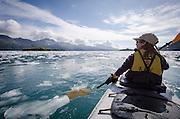 Woman kayaking on Aialik Bay, Kenai Fjords National Park, Alaska