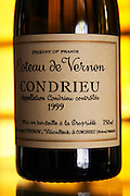 A bottle of Coteau de Vernon Condrieu 1999, detail of label.  Condrieu, Rhone, France, Europe  Domaine Georges Vernay