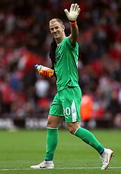Burnley goalkeeper Joe Hart waves to the fans at half-time