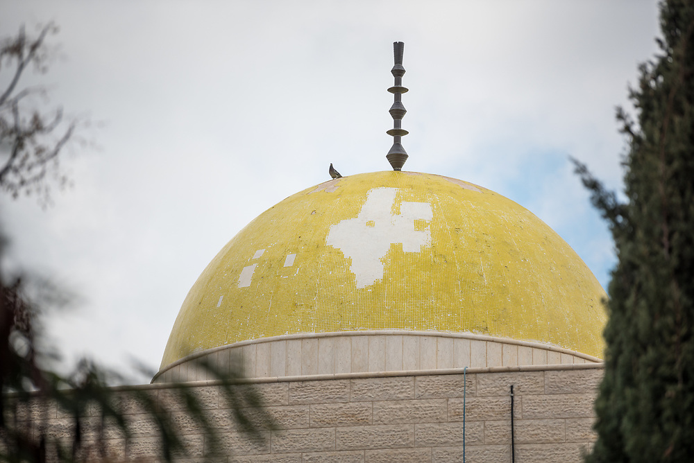 26 February 2020, Abu Dis, Palestine: A bird sits on the dome of the mosque at Al-Quds University in Abu Dis.