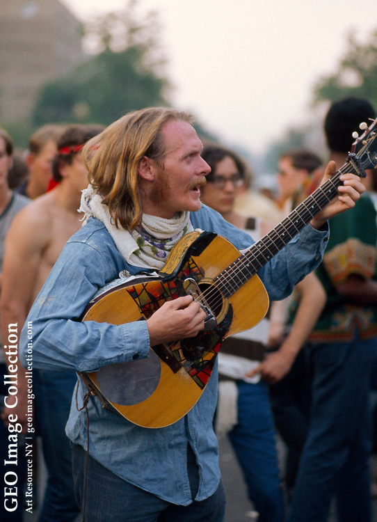 Protester playing a guitar at the March on Washington.