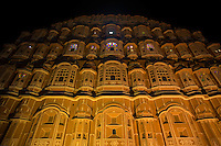 """Hawa Mahal is a one of a kind building because its exterior has 953 windows decorated with intricate latticework. The building is also called """"Palace of Winds"""".  Lal Chand Ustad was the architect of this masterpiece who also planned Jaipur city - much of which is pink colored sandstone like the Hawa Mahal itself.  Hawa Mahal is the symbol and icon of Jaipur """"The Pink City""""."""