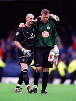 Fabien Barthez (Manchester United) consoles Leicester City Goalkeeper, Tim Flowers after the match.14/10/2000 Leicester City v Manchester United. Credit: Andrew Cowie / Colorsport.