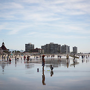 Record breaking heat drove residents and tourists to Coronado Beach in San Diego.