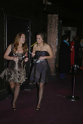 Hannah Robinson and Anna Cordweell, Feathers Ball in aid of the Feathers Clubs. Hammersmith Palais. London. 18 December 2006. ONE TIME USE ONLY - DO NOT ARCHIVE  © Copyright Photograph by Dafydd Jones 248 CLAPHAM PARK RD. LONDON SW90PZ.  Tel 020 7733 0108 www.dafjones.com