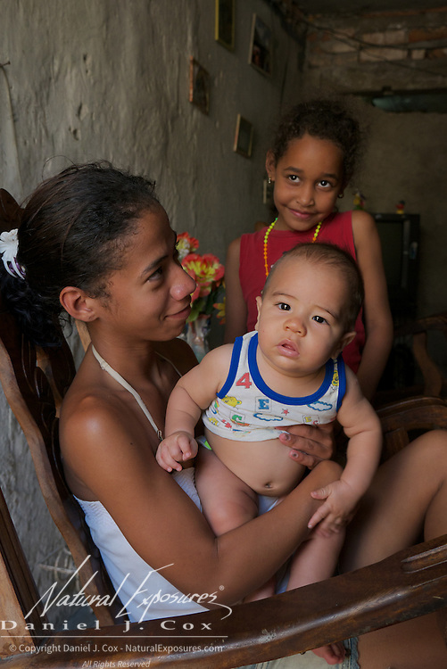 A young Cuban mother with her new baby and family, Ceinfuegos, Cuba
