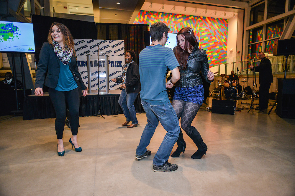 People dancing and having fun at the Akron Art Prize 2014 Grand Finale at the Akron Art Museum.