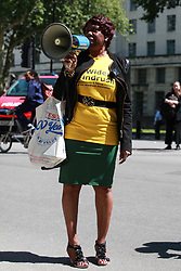 London, UK. 22 June, 2019. Eulalee, a Jamaican grandmother who was imprisoned at Yarl's Wood, addresses campaigners from BAME Lawyers for Justice, comprised of Black Activists Rising Against Cuts (BARAC UK) and an umbrella of other race equality and Windrush justice groups, taking part in a National Windrush Day of Action on Windrush Day to protest against the gross injustice, discrimination and misery suffered by people of the Windrush generation and their multi-generation families, as well as that experienced by people from other Commonwealth and former Commonwealth countries because of the Government's 'hostile environment' policies. Events in London included a rally opposite Downing Street and a march to Westminster Bridge for a mass banner drop. Similar events are taking place in at least six other cities around the UK.
