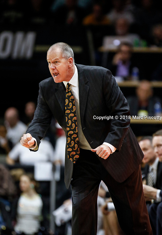SHOT 1/6/18 1:20:06 PM - Colorado Buffaloes head basketball coach Tad Boyle signals in a play for his team during their regular season PAC-12 basketball game against Arizona at the Coors Events Center in Boulder, Co. Colorado won the game 80-77. (Photo by Marc Piscotty / © 2018)