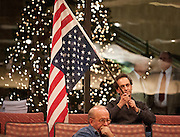 Peter Liacopoulos holds an upside-down U.S. flag in opposition to the proposed tax increases during the second public hearing regarding the proposed 2013 Salt Lake County budget at the Salt Lake County Government Center, Thursday, Dec. 13, 2012.