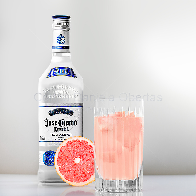 ROME, ITALY - JUNE 6, 2020: Jose Cuervo Especial Silver tequila bottle and Paloma cocktail. The Especial Silver tequila is made of blue agave and is particularly suitable for long drinks.<br /> ONLY FOR EDITORIAL USE! <br /> The use of this image for advertising or promotional purposes is prohibited.<br /> **Find Understand Commercial And Editorial Licenses on the left menu.