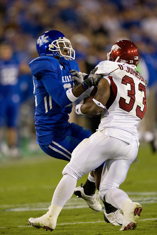 LEXINGTON, KY - OCTOBER 18:   Josh Minton #92 of the Kentucky Wildcats tackles Dennis Johnson #33 of the Arkansas Razorbacks at Commonwealth Stadium on October 18, 2008 in Lexington, Kentucky.  The Wildcats defeated the Razorbacks 21 to 20.  (Photo by Wesley Hitt/Getty Images) *** Local Caption *** Josh Minton; Dennis Johnson