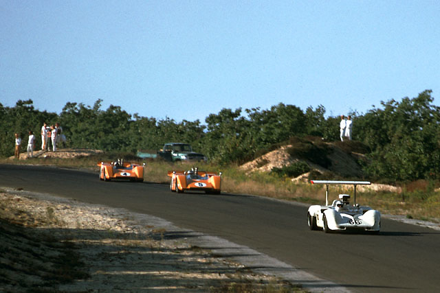 Jim Hall in his Chaparral 2G, its wing feathered flat, leads the pair of McLaren M8s for five glorious laps in the 1968 Bridgehampton Can-Am. Later a fuel system problem dropped the Chaparral back, but neither of the McLarens finished either.