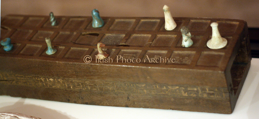 Senet board of Sennefer with game pieces. New Kingdom, 18th Dynasty, 1550-1290 BC. Wood, bone, faience.