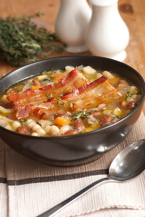 Delicious Tuscan soup with crispy bacon and beans