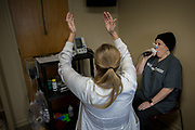 ALMA, GA - MARCH 30, 2021: Christie Simmons, the Director of Bacon County Hospital Pulmonary Rehabilitation, encourages Martin to inhale deeper and fill her lungs during a pulmonary function test. (AJC Photo/Stephen B. Morton)
