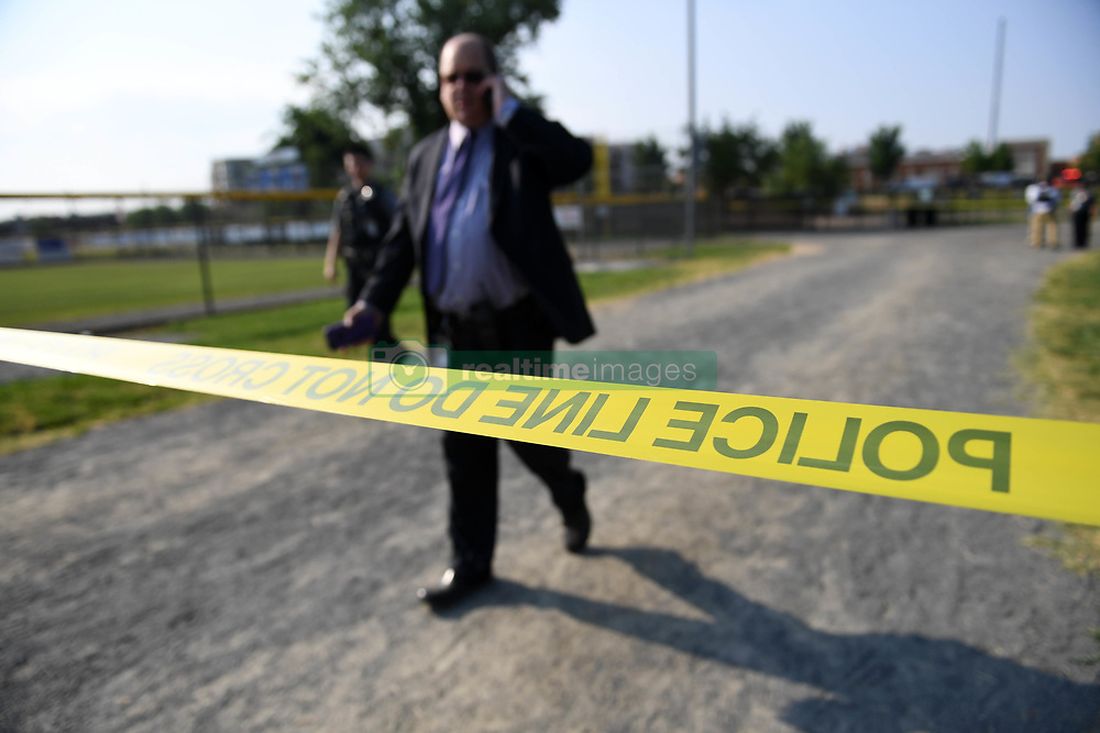 June 14, 2017 - Alexandria, Virginia, U.S. - Police officers work at the site of the gunshot at Eugene Simpson Stadium Park. The gunman who opened fire Wednesday morning at a U.S. congressional baseball practice field has been identified as James T. Hodgkinson, a white male in his 60s. (Credit Image: © Yin Bogu/Xinhua via ZUMA Wire)