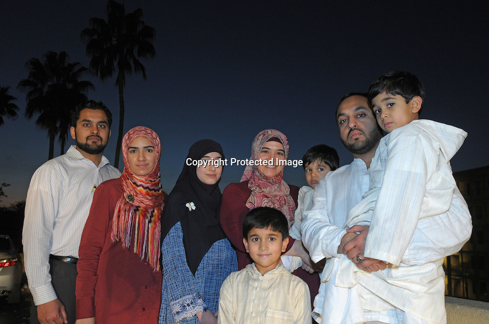 Atif Irfan, from left, his wife, Sobia Ijaz, Sumayya Sahin, 17, Murad Irfan, 7, Inayet Sahin, Sinan Irfan, Kashif Irfan and Luqman Irfan 4, stand outside the Regal Sun Resort in Lake Buena Vista, Fla., Friday, Jan. 2, 2009.  The family were not allowed to board an AirTran flight from Washington, D.C. to Orlando after passengers mistook a conversation their group had about the safest place to sit aboard their plane. (Photo by Phelan M. Ebenhack)